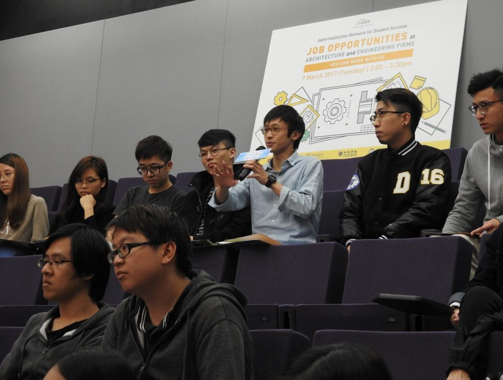 An architecture student raises a question at the Q & A session